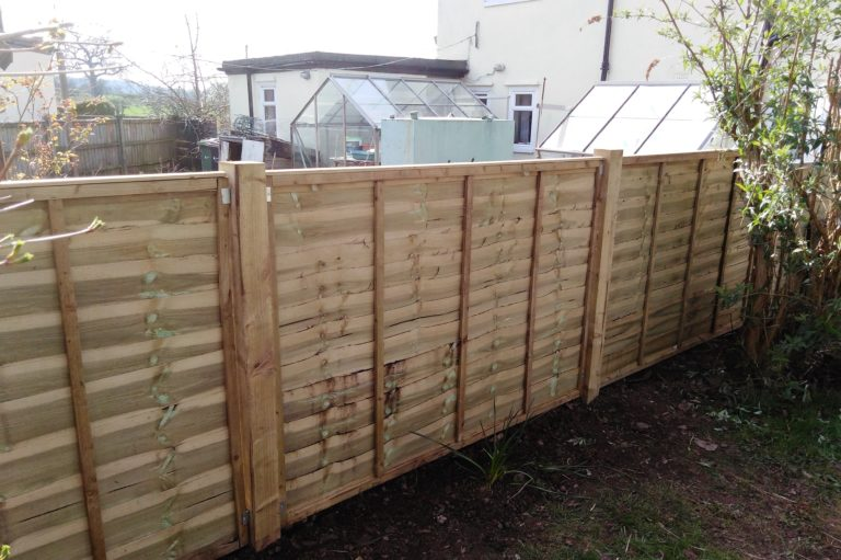 Blown-down fence panels replaced